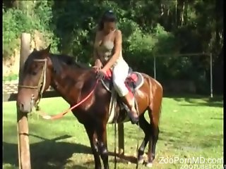 Naked Latina rides on a horse and masturbates