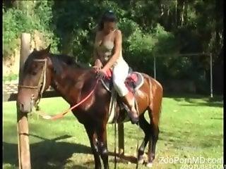 Naked Latina rides on a horse and masturbates