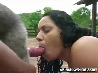 Latina deepthroating a dog's hard red cock on cam