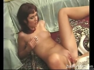 Redhead with perky boobies getting fucked by a dog