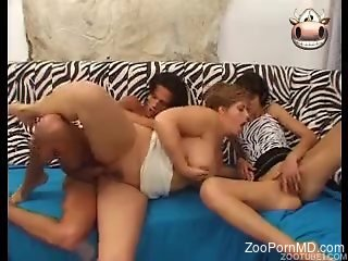Mature zoophile fucks a dog before this threesome